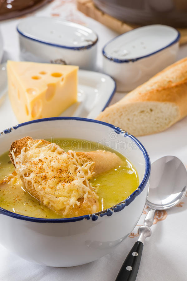 Onion soup. With toast in a white bowl royalty free stock photo