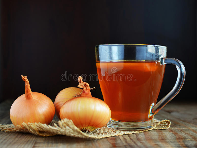 Onion tea for colds homemade folk remedy. In glass mug stock photo