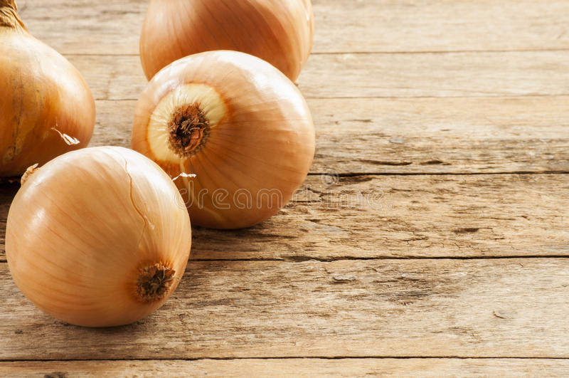 Onion on the wood desk royalty free stock photo