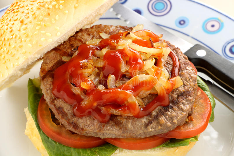 Onions On Beef Burger Royalty Free Stock Photography