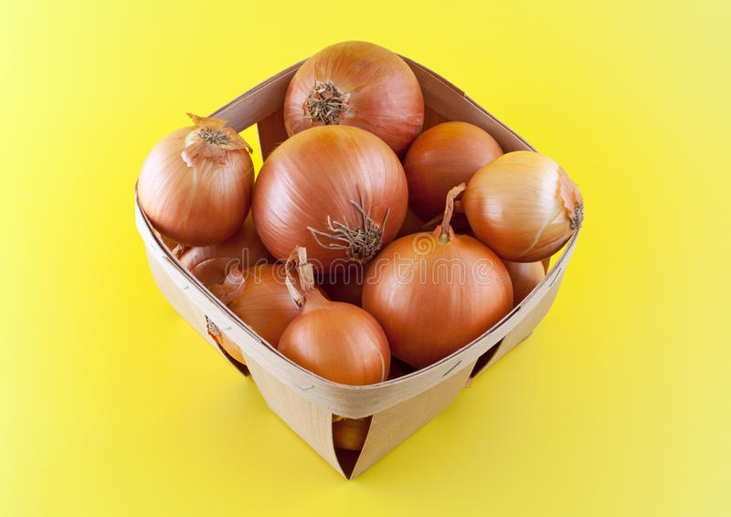 Download Onions In Box On Yellow Background. Stock Image - Image: 20614637