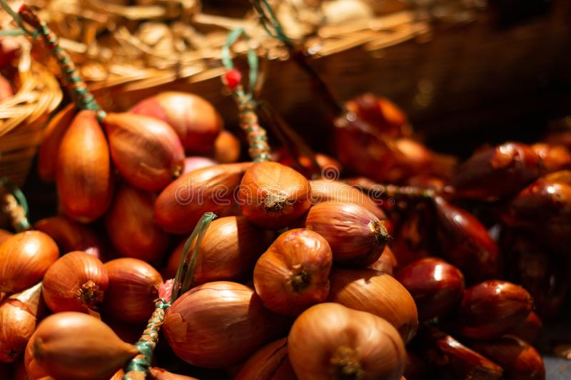 Onions of different colours in a market stall stock image