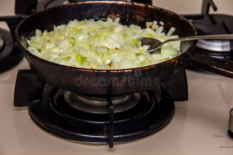 Onions fried in a pan royalty free stock images