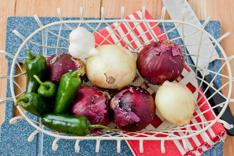 Download Onions And Peppers In A Basket Royalty Free Stock Images - Image: 20704599