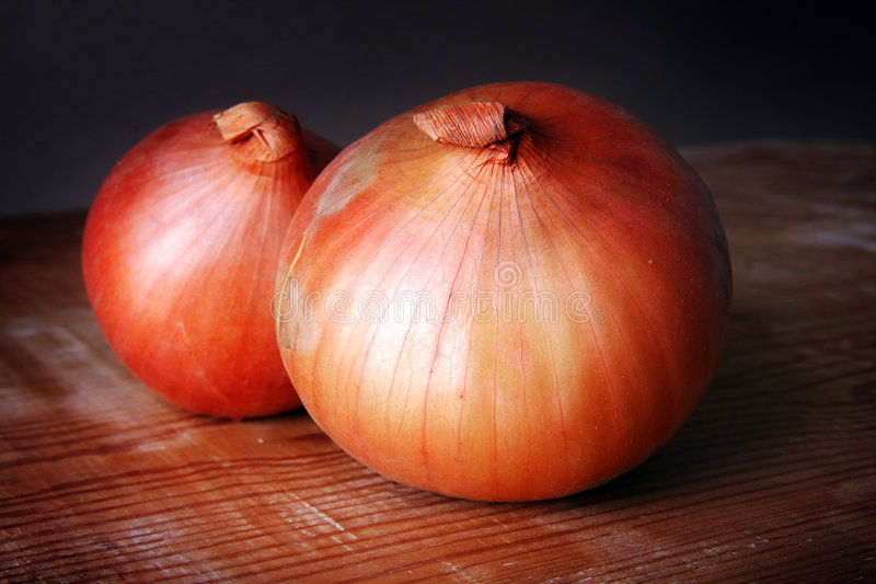 Onions on Wooden Table royalty free stock photo