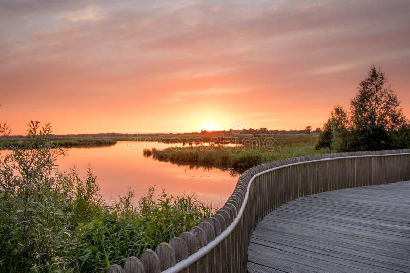 Onlanden solnedgång arkivbild