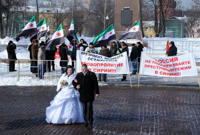 Onlangs Echtpaar en Syrische Protesteerders stock afbeelding