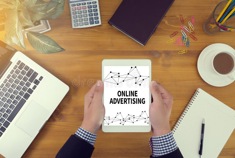 ONLINE ADVERTISING. Businessman youch digital tablet, top view royalty free stock photos