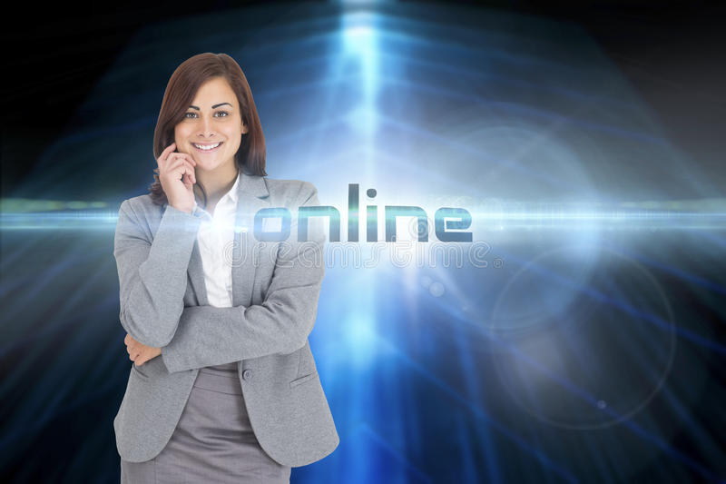 Online against shiny arrow lines on black background. The word online and smiling thoughtful businesswoman against shiny arrow lines on black background royalty free stock image