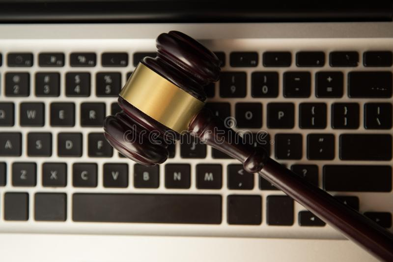 Online auction concept. Auction or judge gavel on a computer keyboard. Judge hammer on laptop computer stock photo