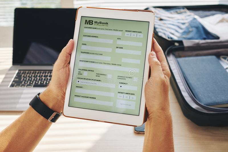 Online bank in touchpad stock image