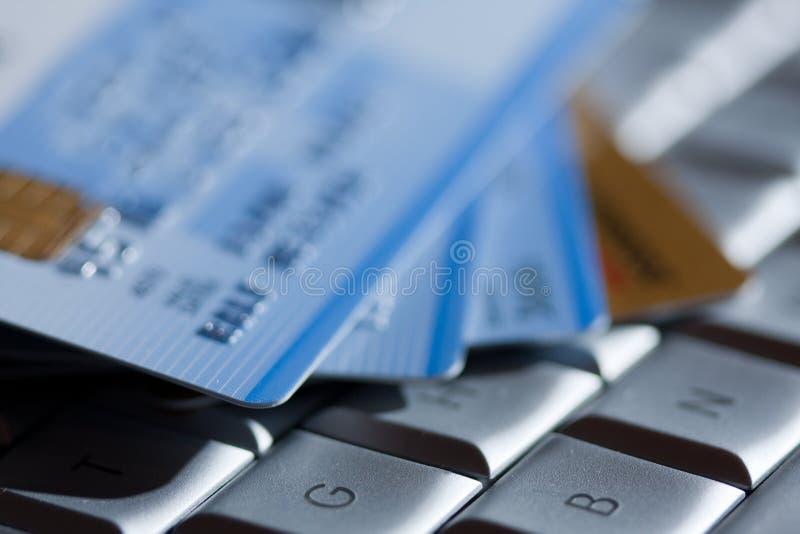 Online banking. Studio shot, credit cards on a notebock keyboard royalty free stock photos