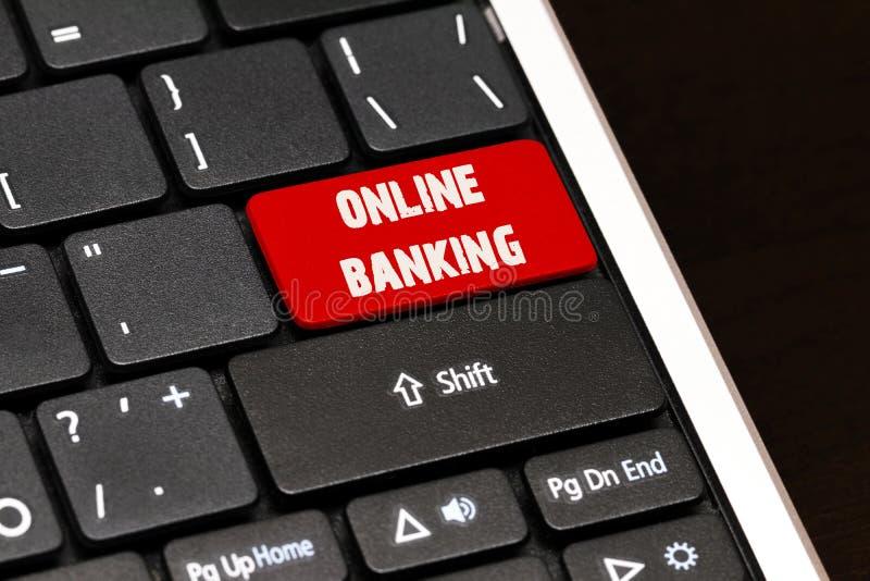 Online bankowość na rewolucjonistce Wchodzić do guzika na czarnej klawiaturze zdjęcia stock
