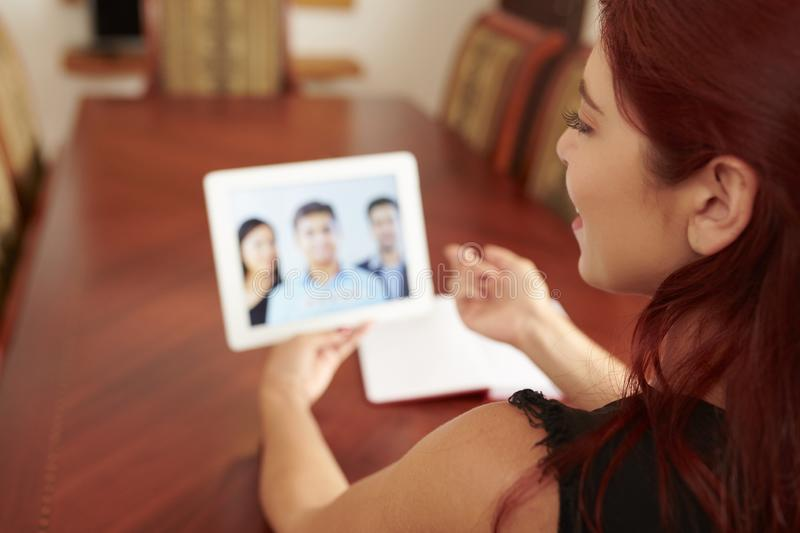 Online business meeting. Young woman having online meeting with coworkers stock image