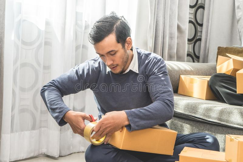 Online business owner packing boxes for delivery royalty free stock photos