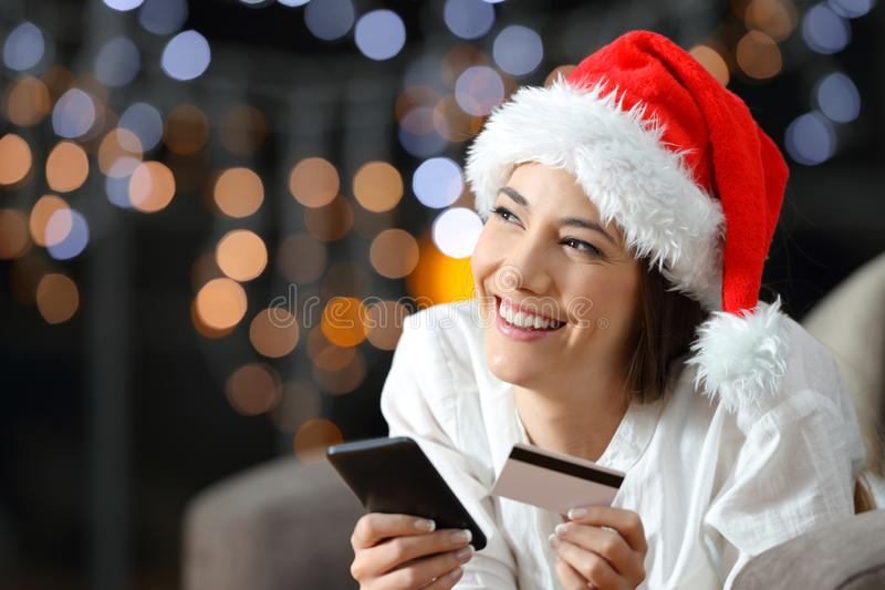Online buyer thinking on chritmas at home royalty free stock photo
