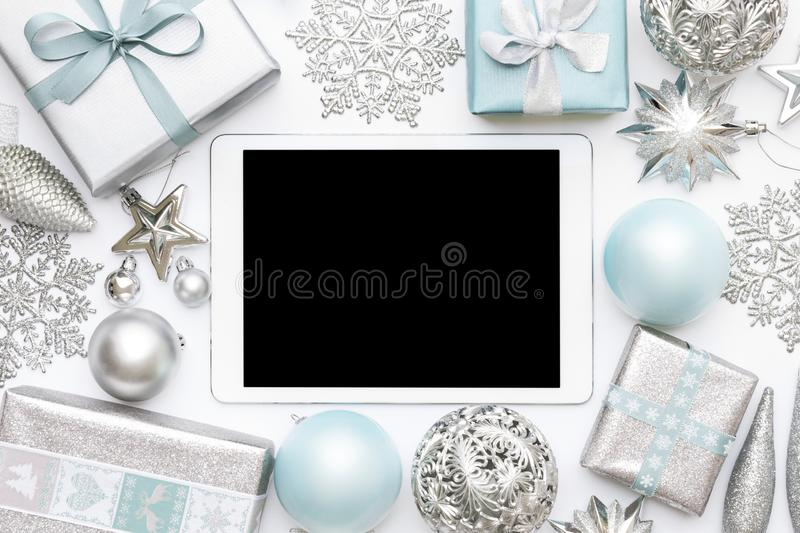 Online Christmas Shopping. Boxing Day Sale Background. Wrapped christmas presents, ornaments and blank screen digital tablet. stock photos