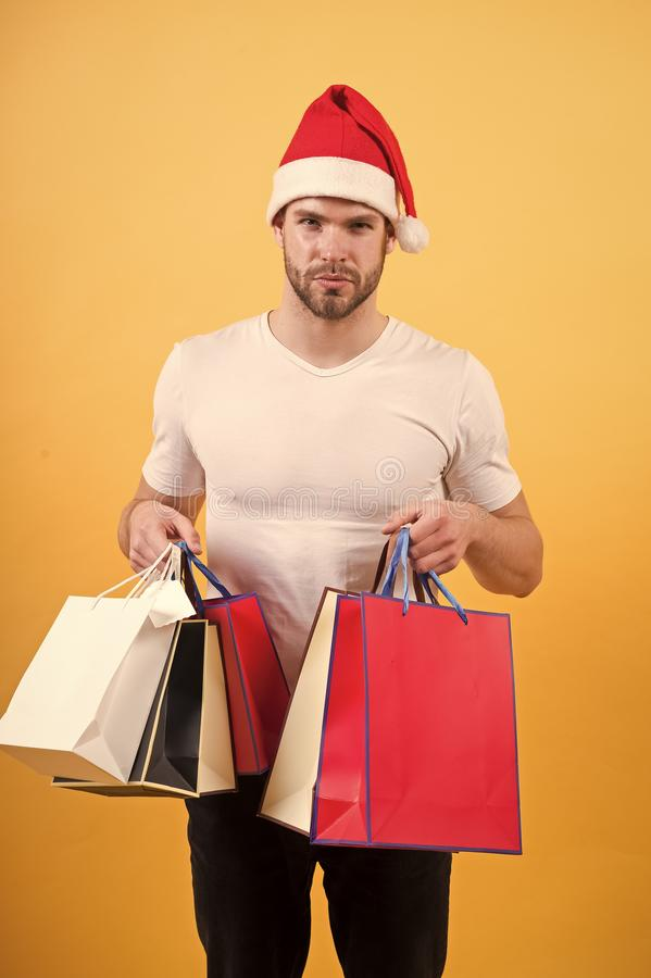 Online christmas shopping. Happy new year. The morning before Xmas. happy santa man on yellow wall. delivery christmas. Gift. man in santa hat hold christmas stock images
