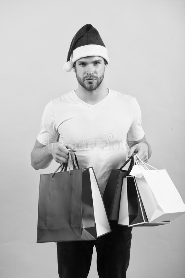 Online christmas shopping. Happy new year. The morning before Xmas. happy santa man on yellow wall. delivery christmas. Gift. man in santa hat hold christmas royalty free stock photography