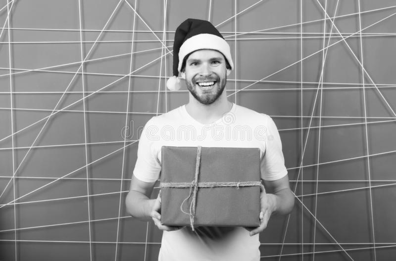 Online christmas shopping. Happy new year. happy santa man. The morning before Xmas. man in santa hat hold christmas. Present. delivery christmas gift. Are you royalty free stock photo