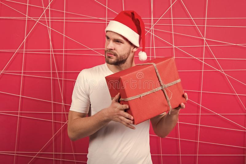 Online christmas shopping. Happy new year. happy santa man. The morning before Xmas. man in santa hat hold christmas. Present. delivery christmas gifts royalty free stock photography