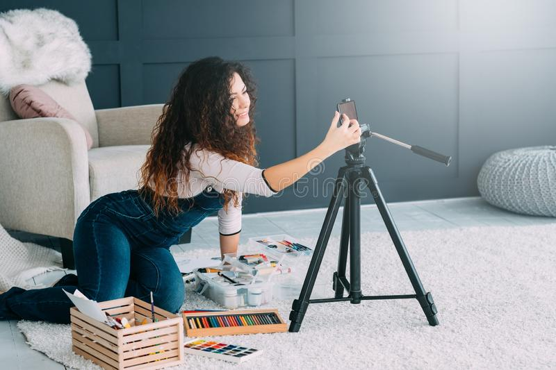 Online communication female artist video chat. Online communication. Female artist using smartphone camera for video chat. Copy space royalty free stock photography