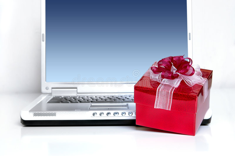 Online contest. Notebook with blank screen and red gift