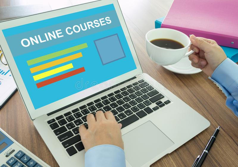 Online course. Businessman using laptop find an online course of interest stock photo