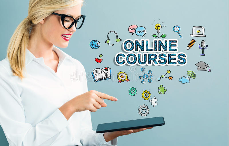 Online Courses text with business woman. Using a tablet royalty free stock photo
