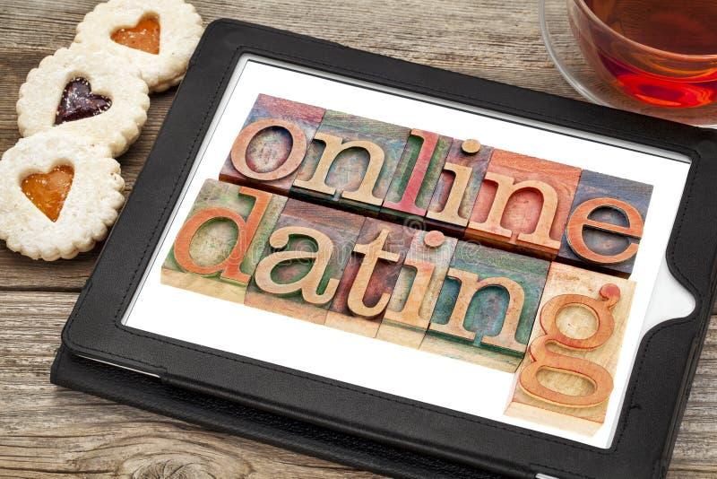 Online-datingonminnestavla royaltyfri foto