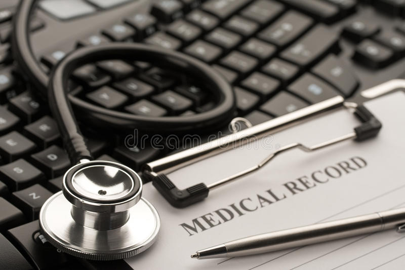 Online doctor. Doctor's stethoscope, patient's medical record and computer keyboard