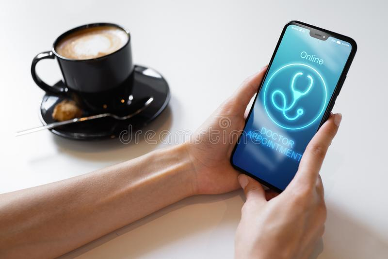 Online Doctor appointment on mobile phone screen. Medical and health care concept. Online Doctor appointment on mobile phone screen. Medical and health care stock images