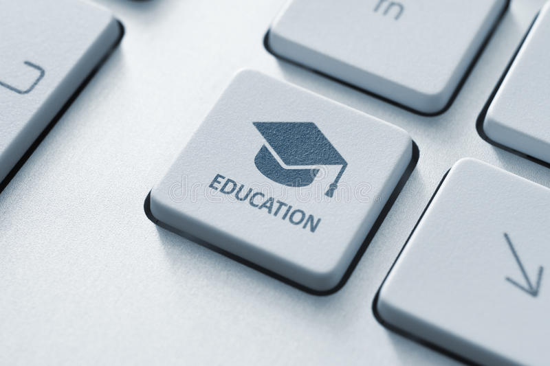 Online education. Button with graduation cap icon on a modern computer keyboard. Online education concept