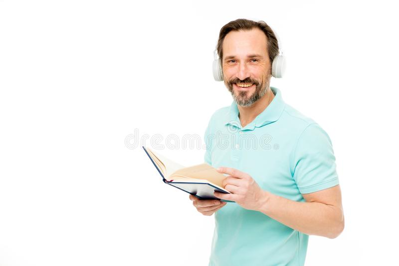 Online education. Man mature bearded guy listening online course. Get more information. Audio book. Reading and stock images