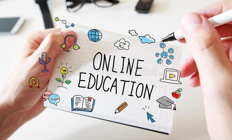 Online Education with mans hands and notebook royalty free stock photography