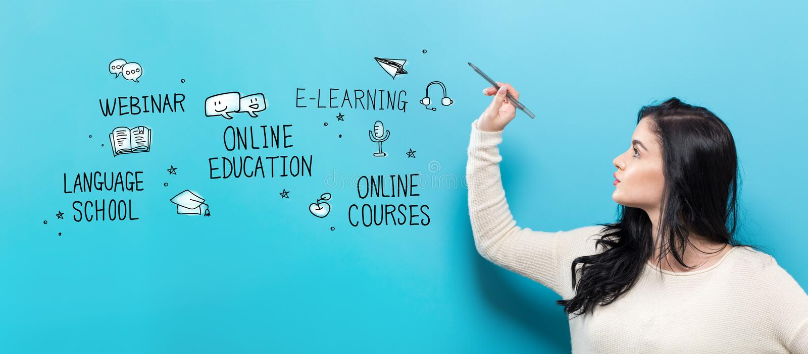 Online Education with young woman holding a pen royalty free stock image
