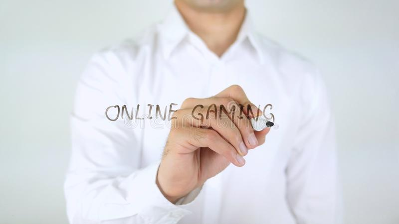 Online Gaming, Man Writing on Glass royalty free stock photos