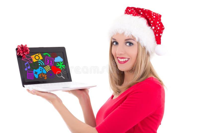 Online het winkelen concept - de gelukkige vrouw in santahoed het kopen presen royalty-vrije stock foto's