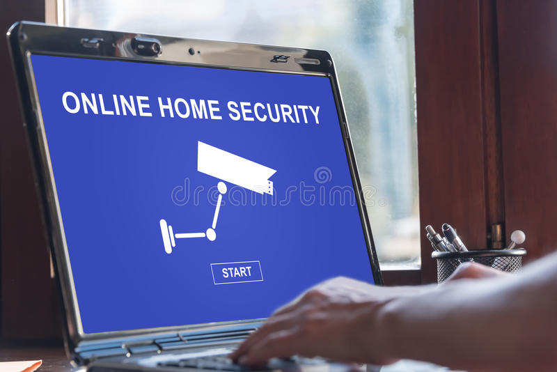 Online home security concept on a laptop screen. Laptop screen displaying an online home security concept stock images