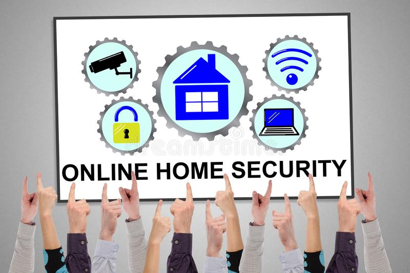 Online home security concept on a whiteboard. Pointed by several fingers royalty free stock photo
