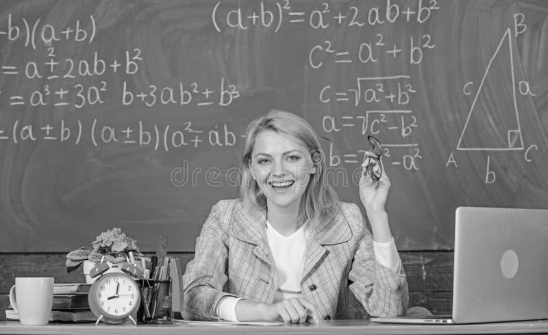 Online job boards or careers pages. Teacher happy work in school chalkboard background. Teacher job description. Teacher. Cheerful pleasant woman educator sit royalty free stock photo
