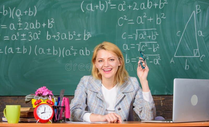 Online job boards or careers pages. Teacher happy work in school chalkboard background. Teacher job description. Teacher. Cheerful pleasant woman educator sit stock photography