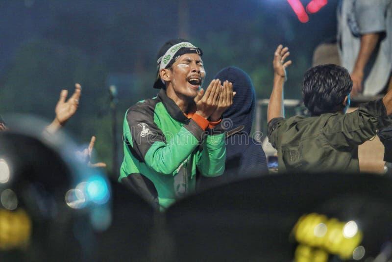 Online kierowcy modlą się dla sprawiedliwości w Dżakarta 2019 wyborów fotografia stock