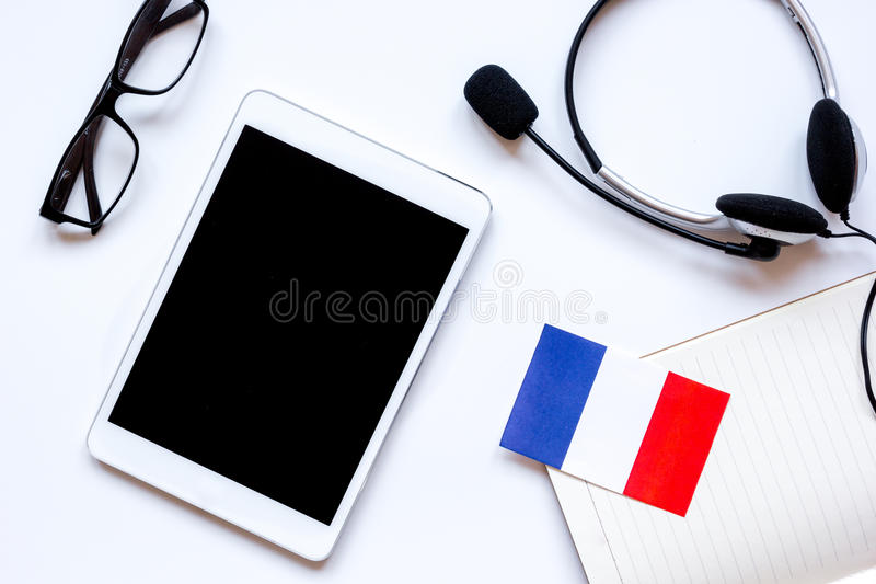 Online language school lifestyle on white table background top view stock photo