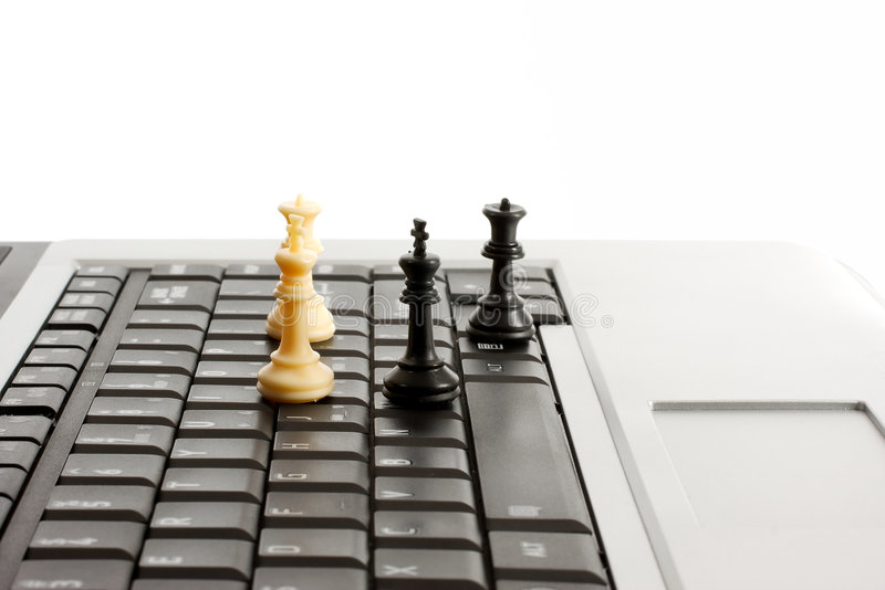 Online laptop chess royalty free stock photos