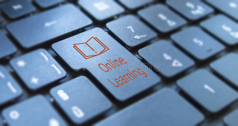Online learning key on keyboard. Online learning key on black keyboard stock photography