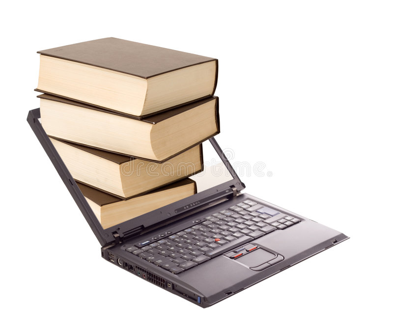 Online library concept. Book stack over laptop - online library and learning concept - isolated stock image