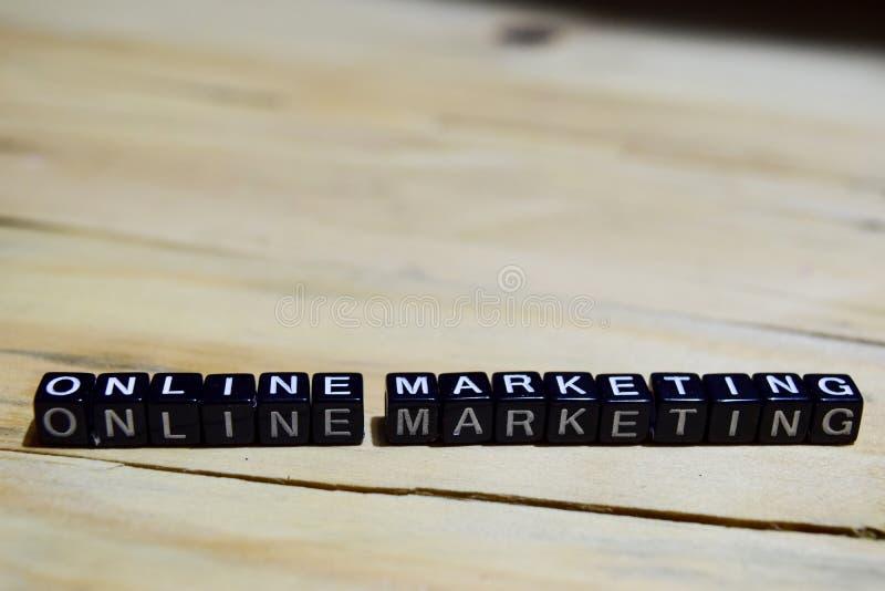 Online marketing written on wooden blocks. stock photos