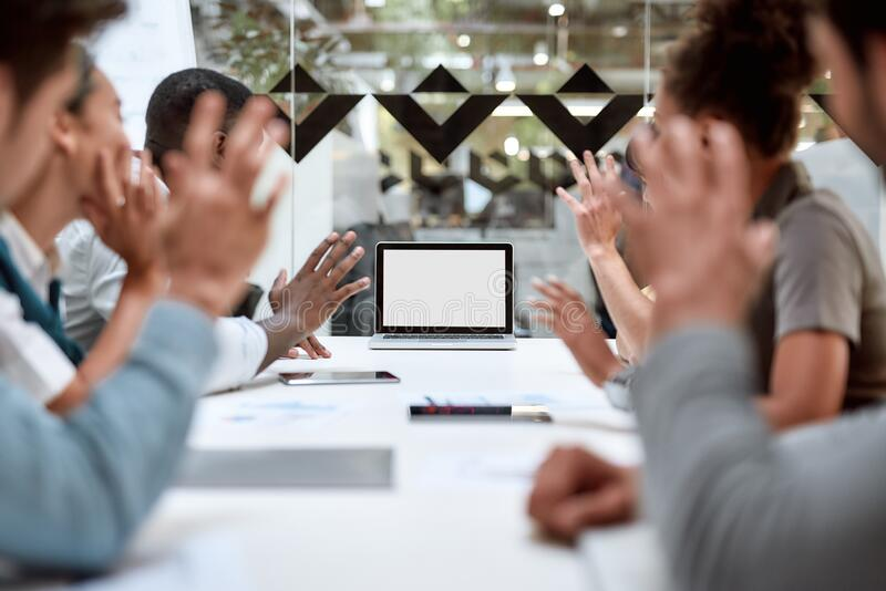 Online meeting. Group of business people having video conference while sitting in the office. Business team looking at. The screen of laptop. Technology concept stock photography