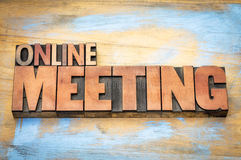 Online meeting word abstract in type. Online meeting word in letterpress wood type against grunge wooden background royalty free stock photos
